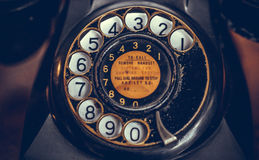 Vintage black phone on old wooden table background. Selective focus Stock Photography