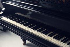 Vintage black piano indoors,. Closeup Royalty Free Stock Image