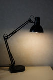 Vintage black reading table lamp turn on in room Stock Images