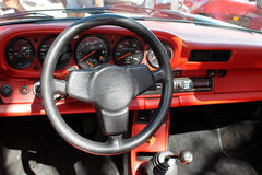 Vintage black and red sports car interior Stock Photos