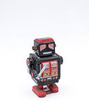 Vintage Black Robot Toy with a Sword on a White Background.  Stock Images