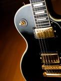 Vintage black rock guitar detail.