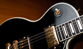 Vintage black rock guitar detail. Stock Image
