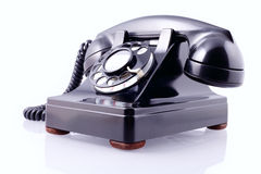 Vintage black rotary phone (with clipping path) Stock Photo
