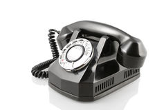 Vintage black rotary phone (with clipping path) Stock Photos