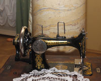 Vintage black sewing machine front view Stock Images