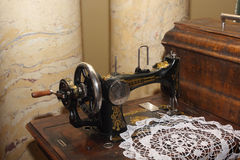 Vintage black sewing machine left view Royalty Free Stock Images