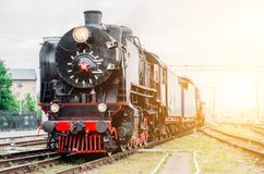 Vintage black steam locomotive train rush railway station. Royalty Free Stock Photos
