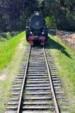 Vintage black steam powered railway train Royalty Free Stock Image