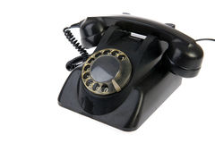 Vintage black telephone. With numbers isolated over white Stock Images
