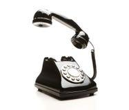 Vintage black telephone. Retro telephone over white background Royalty Free Stock Photos