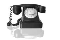 Vintage black telephone. Retro black telephone with reflection isolated on white Stock Images