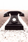 Vintage Black Telephone. On the Aphalt Road Stock Photos