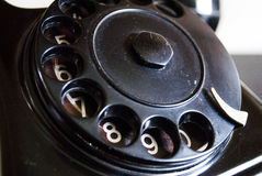 Vintage black telephone dial close up. With numbers. Black and white, monochrome Stock Photos