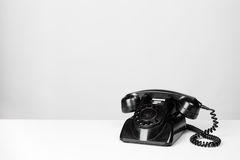 Vintage black telephone on grey background. Old Vintage Black Telephone with grey background Stock Image