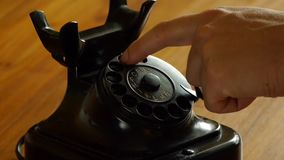 Vintage black telephone - Man dials stock video