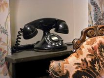 Vintage black telephone Stock Images
