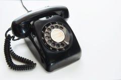Vintage black telephone. On white background, selective focus idea Stock Images
