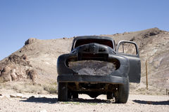 Vintage black truck in desert Stock Photos