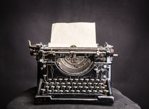 Vintage black typewrite with inserted paper sheet Stock Images