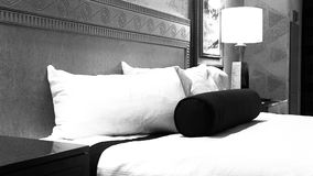 Vintage Black and White Hotel Room. A close up vintage view of a hotel bed stock video