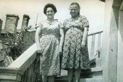 Vintage black and white photo of sisters 1950s European. Vintage black and white photo of sisters wearing dresses, older, family. 1950s fashion. Social history royalty free stock images
