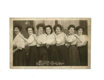 Vintage black and white photo of women possibly in 1900s uniform - Social History. Black and white photo of 1900s women in uniform, 1900s fashion. Social history stock images