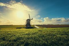 Vintage Black Windmill during Sunset Royalty Free Stock Photos