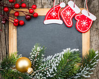 Vintage blackboard blank framed in Christmas tree branch and dec Royalty Free Stock Image