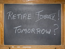 Vintage blackboard chalk retirement message. The grungy scratched and filthy blackboard displays a printed message in chalk.  The concept of retire today or Stock Images