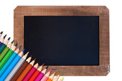Vintage blackboard and colorful pencils. School concept Stock Photography