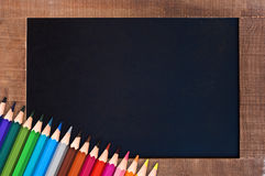 Vintage blackboard and colorful pencils. School concept Stock Photos