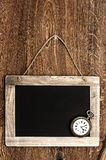 Vintage blackboard hanging on wooden wall Royalty Free Stock Photography