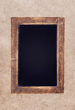Vintage blackboard on textured  background Stock Photography