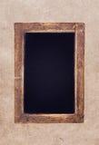 Vintage blackboard on textured  background Stock Photography