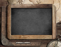 Vintage blackboard with treasure map, old compass. And ruler Royalty Free Stock Photo