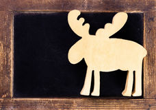Vintage blackboard with wooden frame and Christmas deer. Blank c Royalty Free Stock Photo