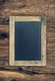 Vintage blackboard on wooden wall. Chalkboard texture Royalty Free Stock Photo