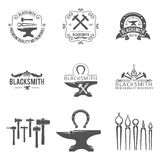 Vintage blacksmith and metalworks logos, emblems Royalty Free Stock Photography