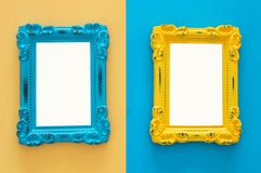 Vintage blank blue and yellow photo frames over double colorful background. Ready for photography montage. Top view from above. Vintage blank blue and yellow stock photo