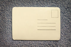 Vintage blank card. On asphalt texture background with copy space Stock Photos
