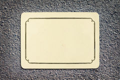 Vintage blank card on asphalt texture. Background with copy space Royalty Free Stock Images