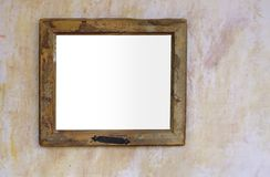 Vintage blank frame, grungy and worn. Vintage blank frame, worn, free picture space, free copy space,against grungy wall Stock Photos