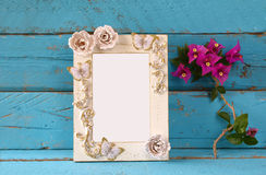 Vintage blank frame next to beautiful purple mediterranean summer flowers. template, ready to put photography.  Royalty Free Stock Photo