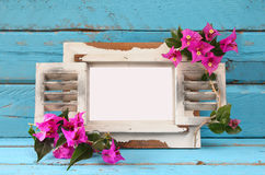 Vintage blank frame next to beautiful purple mediterranean summer flowers. template, ready to put photography Royalty Free Stock Photo