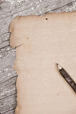 Vintage blank paper on rustic table Stock Image