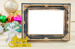 Vintage blank photo frame with christmas decorations on wood bac Royalty Free Stock Image