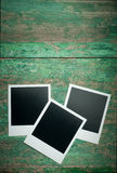 Vintage blank photo on wooden table Royalty Free Stock Images