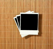 Vintage Blank Polaroid Frames. Crooked Old Blank Polaroid Frames on Bamboo Royalty Free Stock Photo