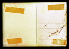 Vintage blank postcard background with stains Stock Image